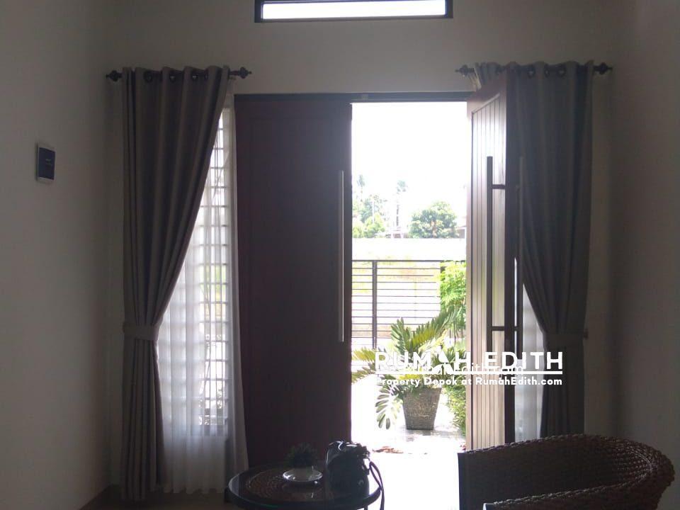Rumah Cantik Desain Modern 2 lt di Harjamukti Cibubur 1,8 M nego 2