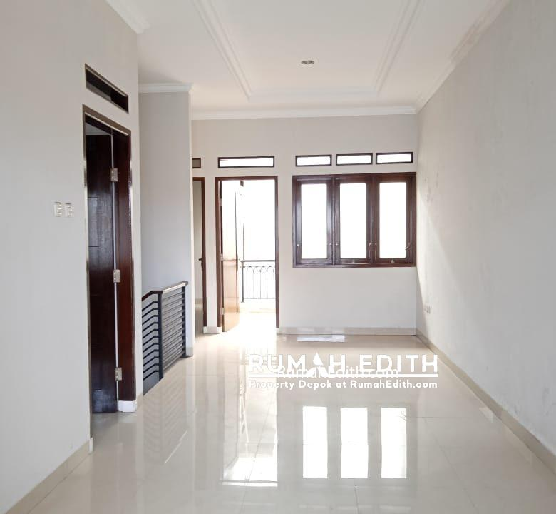 Dijual rumah siap huni 2 lantai 1,6M nego di pinggir jln raya asmawi Beji kukusan 2