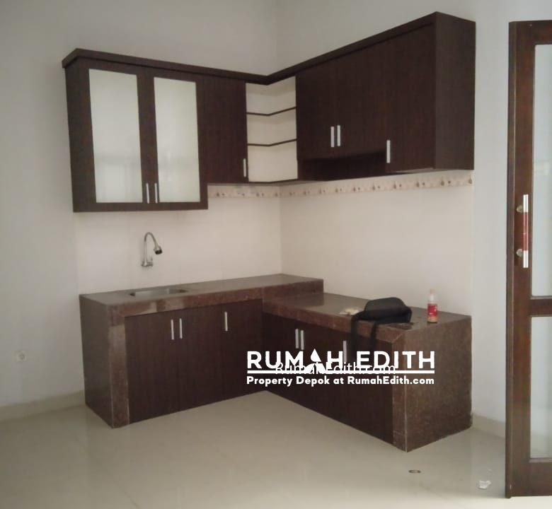 Dijual rumah siap huni 2 lantai 1,6M nego di pinggir jln raya asmawi Beji kukusan 4
