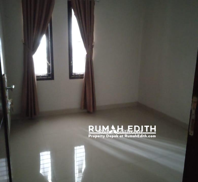 Dijual rumah siap huni 2 lantai 1,6M nego di pinggir jln raya asmawi Beji kukusan 7